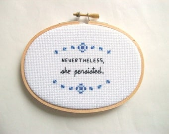 Nevertheless She Persisted cross stitch -- completed 3x5 cross stitch
