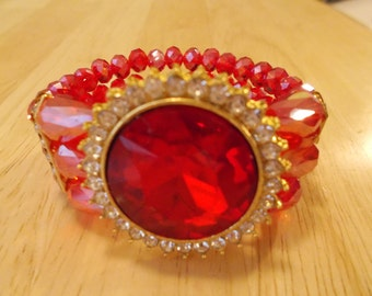 Reduced 3 Row Red Crystal Stretch Cuff Bracelet with Gold Tone Frame and Clear Rhinestones