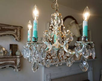 Farmhouse rustic chandelier lighting hand painted Caribbean aqua blue w/ white crystals drops w/ garland light home decor anita spero design