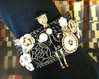 Iconic One-of-a-Kind Bracelet Authentic and Inspired embellishments. Gunmetal chain leather cuff bracelet. Brooch Buttons Flowers Lady Coco