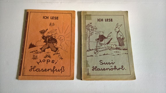 Vintage German Children's Book Set by Valerie Bittner -- Susi Hasenohrl - Eugenie Schilling - Hopsi Hasenfuss - Learning a Language for Kids Vintage German Children's Book Set by Valerie Bittner -- Susi Hasenohrl - Eugenie Schilling - Hopsi Hasenfuss - Learning a Language for Kids Vintage German Children's Book Set by Valerie Bittner -- Susi Hasenohrl - Eugenie Schilling - Hopsi Hasenfuss - Learning a Language for Kids Vintage German Children's Book Set by Valerie Bittner -- Susi Hasenohrl - Eugenie Schilling - Hopsi Hasenfuss - Learning a Language for Kids Vintage German Children's Book Set by Valerie Bittner -- Susi Hasenohrl - Eugenie Schilling - Hopsi Hasenfuss - Learning a Language for Kids ?zoom Item details 5 out of 5 stars. (635) reviews Shipping & Policies Two vintage children's books in German. Perfect for adults and kids alike learning the language! This set includes two books: - Susi Hasnohrl and Eugenie Schilling, copyright 1949 - Hopsi Hasenfuss, copyright 1949, 1956. Ich Lese (I Read) Lese Ubungshefte für Volksschulder (Reading Exercises for Young People) Bild und Schrift: Valerie Bittner (Picture and Writing: Valerie Bittner) Birkin-Verlag,Wien (Birkin Publishing Company, Vienna). Printed in Austria. Each book is paperback and measures 6