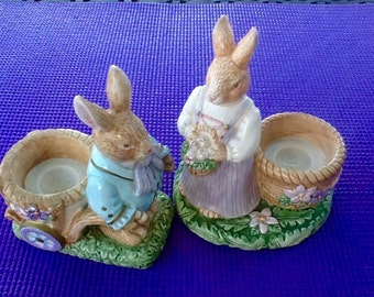 Avon Springtime Bunny Tea Lite Holders. Man/Woman Pr.Lavender and Blue. Also can hold an Easter Egg. Set of 2. 6 by 4 inches. Avon Porcelain