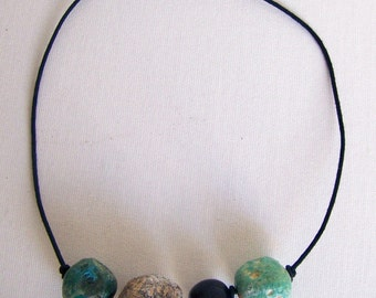 This stunning piece is made with handmade clay beads which has turquoise and blue tones. Is light in wearing.