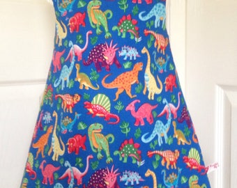 Pinafore girls dress, Nutex Dinosaur Dance, age 3, 100% cotton, fully lined, shoulder button fastening.