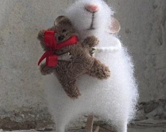 Mouse with a bear.The little felt mouse.