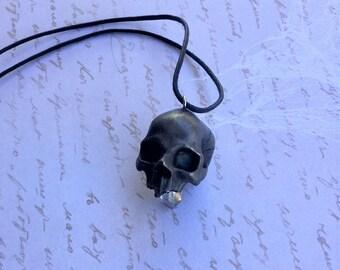 Embedded quartz crystal skull pendant