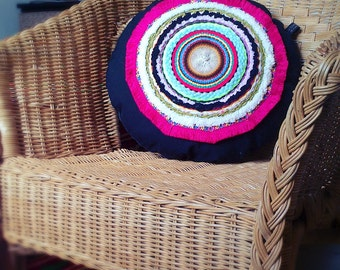 woven multicolored round cushion