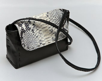 Leather small bag – black and white snake relief pattern on the cover.