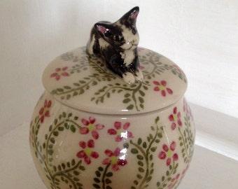 Ceramic storage jar with cat lid