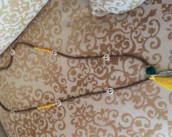 Peace symbols, tassel and leaf necklace