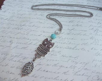 Owl necklace with silver leaf and turquoise stone