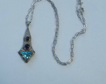 Sterling Silver, Amethyst and Blue Topaz Pendant on a Sterling Chain.  (556)