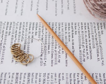 Round stitch markers for lace knittting; pack of 10 brass rounds with holder