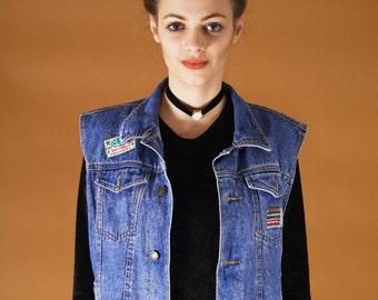 Cool 90s vintage denim vest with colorful patches // blue vintage jeans vest