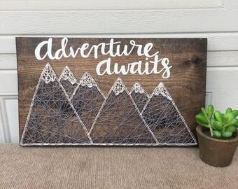 Adventure awaits string art mountain sign