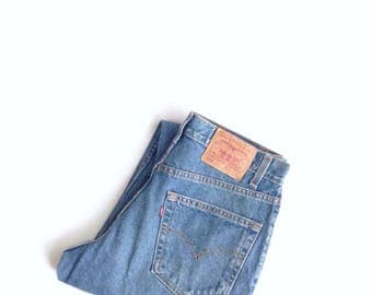 90's boyfriend jeans. W30 L31. Levis 550 red tab, , relaxed fit, dark wash, cotton jeans.