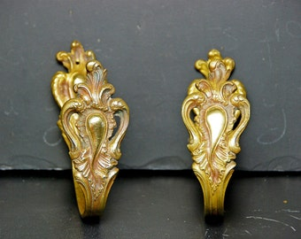 Pair of ormolu antique French curtain or drapery tie backs dating from the late 1800s, chateau, Louis XVstyle.