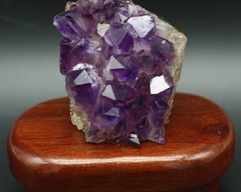 Amethyst from Uruguay on stained wood stand.
