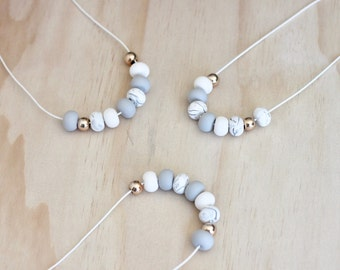 Polymer clay beaded necklace. Marble, light grey, white and rose gold beads 'the macy'