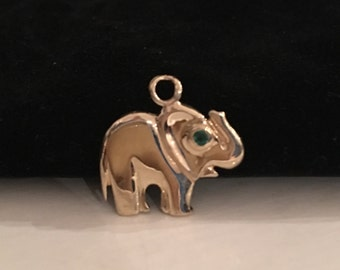 14k Yellow gold Elephant Charm with Trunk Up for Good Luck and Green Stone For Eye