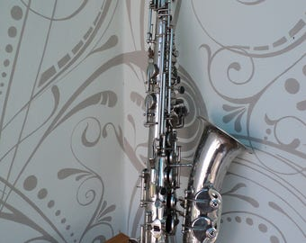 Antique silver Tenor tone saxophone in 1963, Leningrad, the USSR. Musical instrument.