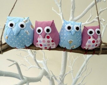 Owl family on a branch, 4 pink and blue pastel owls