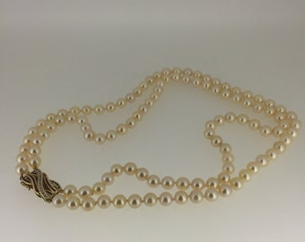 Double Strand Natural Pearl Necklace with Gold and Precious Stones Buckle