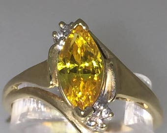 1.5ct Marquise Shaped Golden Zirconia and Diamond ring in 14K Yellow Gold