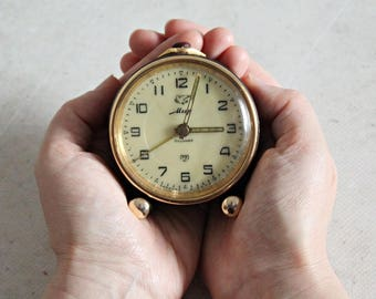 Vintage alarm clock, Soviet alarm clock, made in USSR, black and gold alarm clock, Mir, 11 Jewels