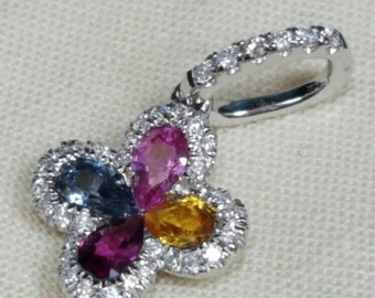 Multi color sapphire and diamond pendant set with four pear-shaped sapphires.