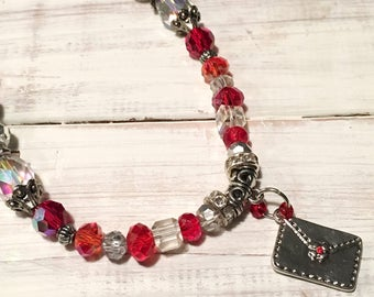 Red Beaded necklace with Silver Handbag Charm