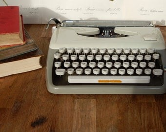 A Vintage Retro Adler Tippa Typewriter, with case,good condition.Desk addition, collectable, stationary