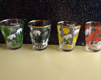 Vintage set of 4 Mid Century kitsch shot/tot glasses with lucky symbol design. Barware