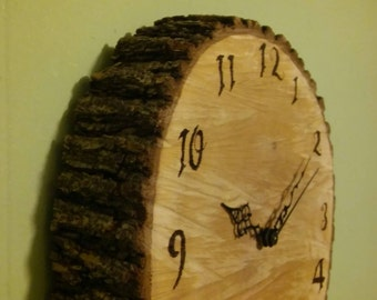 Outdoors rustic natural wooden tree clock with live edge