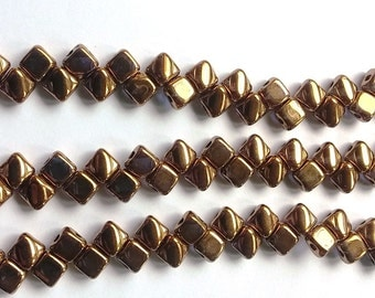 6MM Silky Crystal Gold Luster, 2 hole Czech Glass 00030-90215, 40 beads