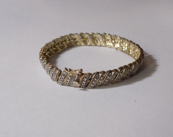 Gold tone sterling silver bracelet 7 1/2 inches long 26 grams and 8.5 mm wide