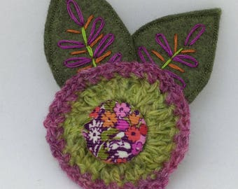 Crochet and felt flower brooch with liberty fabric button and hand embroidered leaves