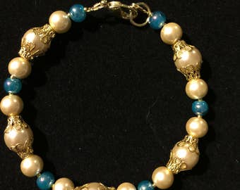 Large 8 1/2 inch faux pearl, teal and gold plate bracelet