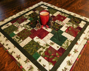 Quilted Christmas Wall Hanging/Table Topper in Christmas fabrics of green, red, white