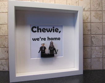 Chewie, we're home! Star Wars picture - Han Solo and Chewbacca figures on a LEGO® brick