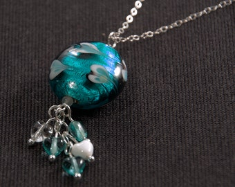 Sterling silver and teal lampworked glass pendant with heart pattern