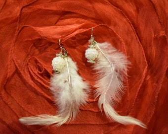Feather and bead earrings.