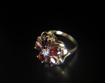 10K yellow ring flower ring with garnets and diamond, size 5, weight 3.6 grams