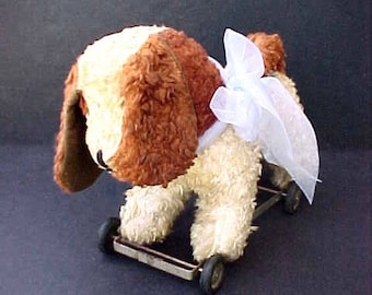 Sweet Vintage Dog On Wheels Toy with Wagging Tail