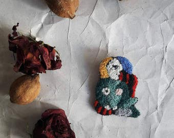 Embroidered brooch (Picasso)