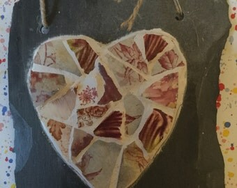 Old Red broken china mosaic heart on slate
