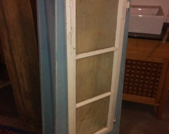 Beautiful stand display cabinet with an old window