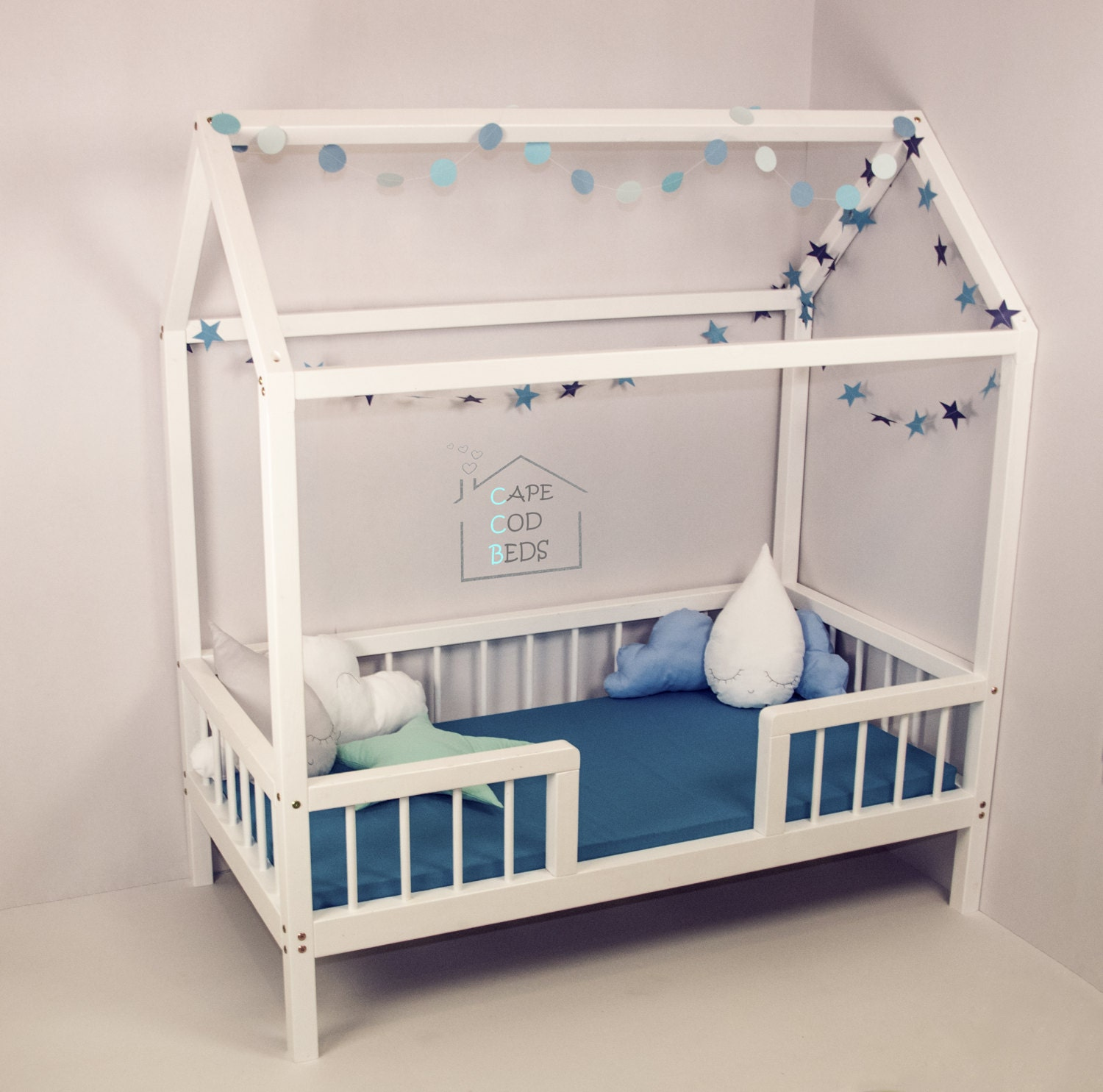 Crib size house shaped bed on legs with rails house bed for Frame house bed
