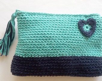 Crochet pouch in navy and aqua blue