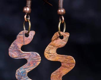 Hammered copper snake earrings